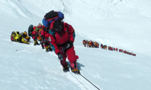 A photograph of a line of climbers taken on Everest